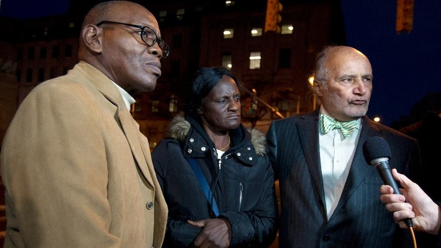 Richard Shipley, Freddie Gray'stepfather, left, with Gray's mother Gloria Darden and lawyer Billy Murphy speaks with the media after a mistrial was declared in the manslaughter trial of Officer William Porter, one of six Baltimore city police officers charged in connection to the death of Freddie Gray on Wednesday, Dec. 16, 2015, in Baltimore Md. (AP Photo/Jose Luis Magana)