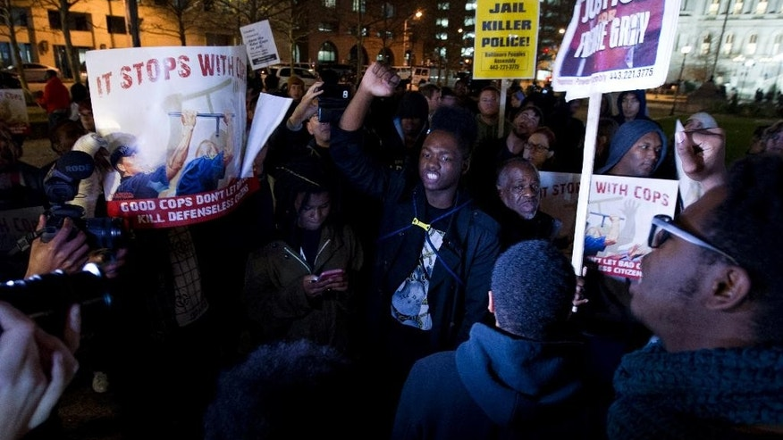 Demonstrators protest outside of the city hall in response to a hung jury and mistrial for Officer William Porter, one of six Baltimore city police officers charged in connection to the death of Freddie Gray, Wednesday, Dec. 16, 2015, in Baltimore Md. (AP Photo/Jose Luis Magana)