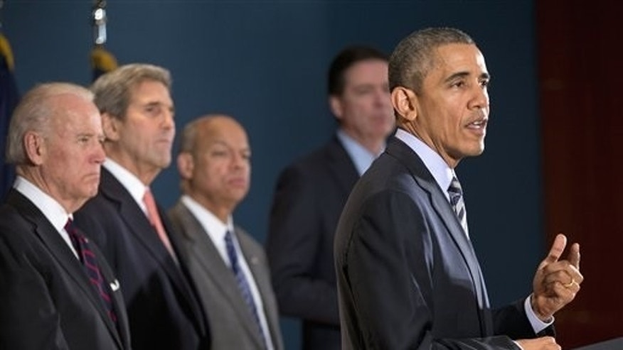 President Barack Obama speaks at the National Counterterrorism Center in McLean, Va.,Thursday, Dec. 17, 2015. Joining him, from left are,, Vice President Joe Biden, Secretary of State John Kerry, Homeland Security Secretary Jeh Johnson, and FBI Director James Comey. The president said U.S. intelligence and counter-terrorism professionals dont have any specific, credible information suggesting a terrorist attack on the U.S. during the holidays. (AP Photo/Pablo Martinez Monsivais)