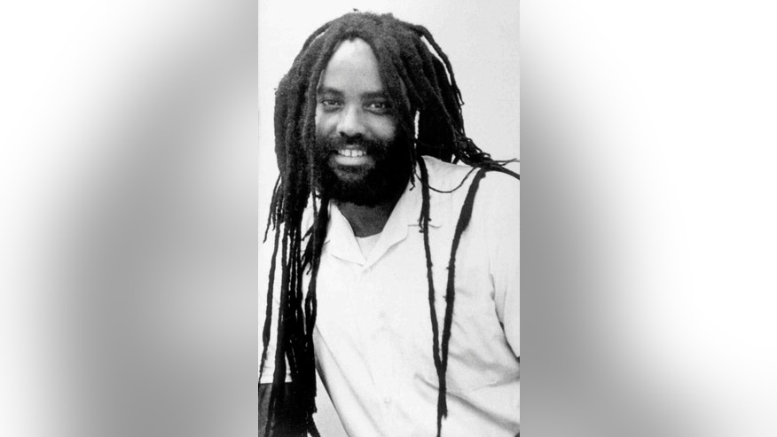 "FILE -This undated file photo shows convicted police killer Mumia Abu-Jamal. Former death row inmate Mumia Abu-Jamal will get a chance to tell a federal judge that his medical care for hepatitis C and other health problems has been inadequate. Claiming prison officials have shown  ""deliberate indifference"" to his health, former death row inmate Mumia Abu-Jamal will get a chance to argue his case before a federal judge on Friday, Dec. 18, 2015. (AP Photo/Jennifer E. Beach, File)"