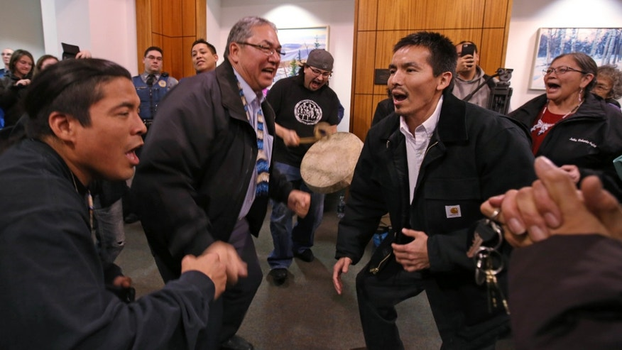 Dec. 17, 2015: Marvin Roberts, right, and Tanana Chiefs Conference President Victor Joseph, left, dance with friends and family at the Rabinowitz Courthouse in Fairbanks, Alaska.