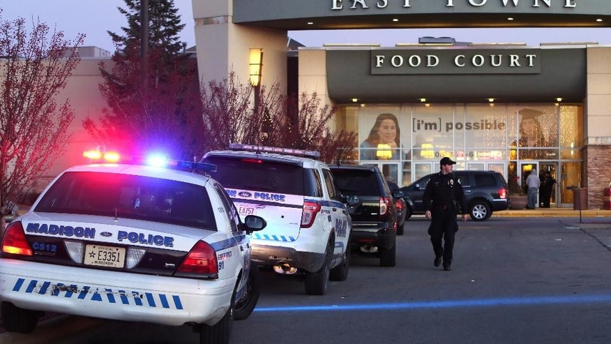 "Authorities respond to reports of shots fired at East Towne Mall in Madison, Wis., Saturday, Dec. 19, 2015. Madison police said one person was shot in the leg during a ""disturbance"" inside the mall but his injuries are not life threatening. (Amber Arnold/Wisconsin State Journal via AP) MANDATORY CREDIT"
