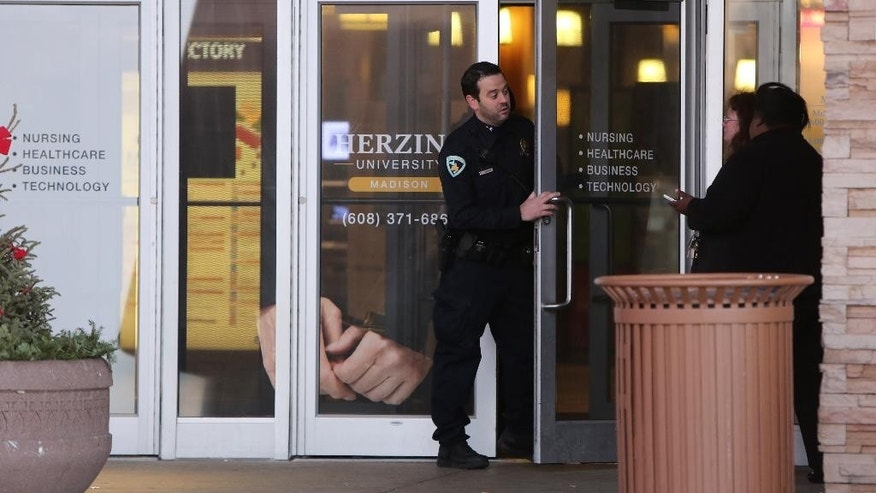 "Authorities respond after reports of shots fired at East Towne Mall in Madison, Wis., Saturday, Dec. 19, 2015. Madison police said one person was shot in the leg during a ""disturbance"" inside the mall but his injuries are not life threatening. (Amber Arnold/Wisconsin State Journal via AP) MANDATORY CREDIT"