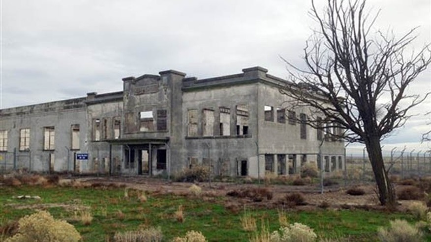In this undated photo provided by the U.S. Department of Energy, the ruins of the old Hanford High School are shown near Richland, Wash. (Courtesy of the U.S. Department of Energy via AP)