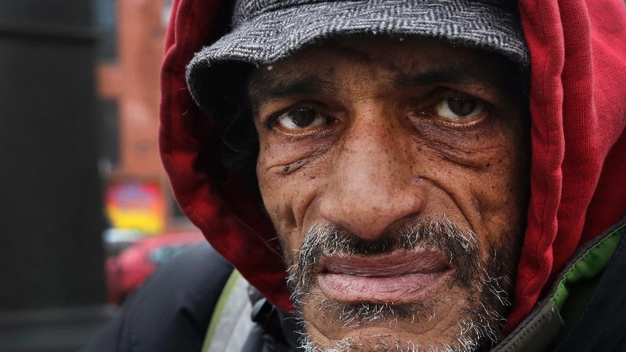 Nelson Tito, who says he has been homeless for years, poses for a photo, Monday, Dec. 21, 2015 in New York. Homeless advocacy groups are threatening legal action against the city over its plans to conduct an aggressive homeless outreach program. The groups say they fear police involvement in the campaign will result in more arrests of homeless people. (AP Photo/Mark Lennihan)