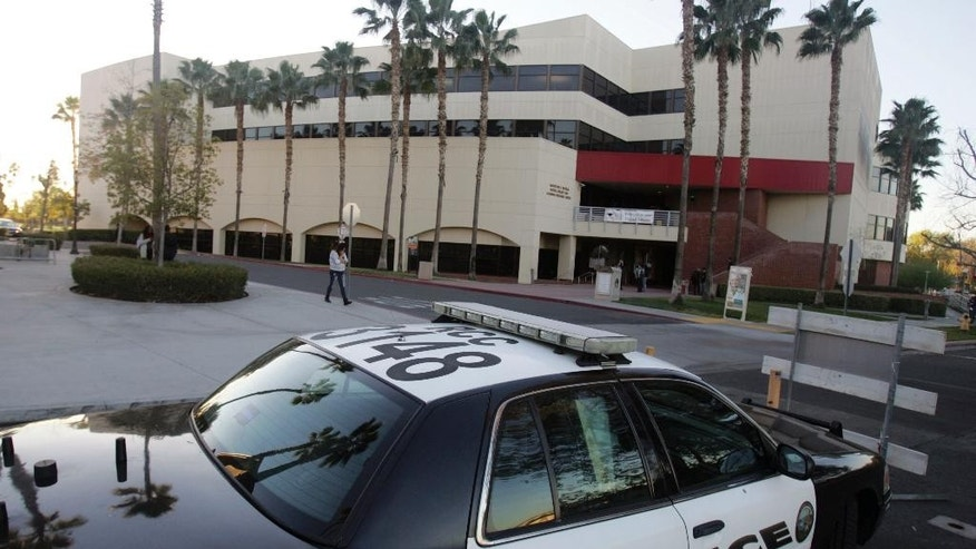 A campus police car sits park just outside the library on Thursday, Dec. 17, 2015 at Riverside City College in Riverside, Calif. Enrique Marquez, the former neighbor and close friend of San Bernardino shooter Syed Rizwan Farook, has been charged with conspiring to provide material support to terrorists for those earlier plots with Syed Rizwan Farook. (Stan Lim/The Press-Enterprise via AP)  MAGS OUT; MANDATORY CREDIT; LOS ANGELES TIMES OUT