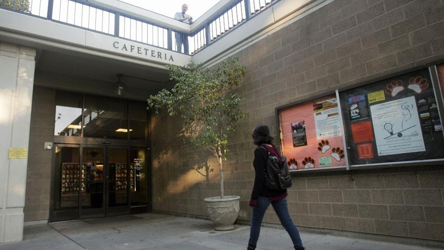 A student makes her way into the cafeteria on Thursday, Dec. 17, 2015 at Riverside City College in Riverside, Calif. Enrique Marquez, the former neighbor and close friend of San Bernardino shooter Syed Rizwan Farook, has been charged with conspiring to provide material support to terrorists for those earlier plots with Syed Rizwan Farook. (Stan Lim/The Press-Enterprise via AP)  MAGS OUT; MANDATORY CREDIT; LOS ANGELES TIMES OUT