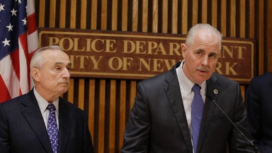 "FILE- In this June 4, 2014, file photo, made in New York, New York Police Chief of Detectives Robert Boyce speaks to the media as Police Commissioner William J. Bratton, left, looks on. Although outlaw street gangs are engaging in more of a white-collar variety of crime, they are not shifting away from violence. In an interview with The Associated Press, Boyce recently said that, ""These street crews are putting down the drugs for the credit cards, and then killing over the cards."" (AP Photo/Frank Franklin II, File)"