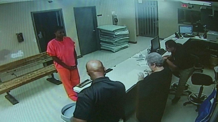 FILE  - In this undated file frame from video provided by the Waller County Sheriff's Department, Sandra Bland stands before a desk at Waller County Jail in Hempstead, Texas. A grand jury decided that neither sheriff's officials nor jailers committed a crime in the treatment of Bland, a black woman who died in a Texas county jail last summer, but has not yet determined whether the state trooper who arrested her should face charges, a prosecutor said. (Waller County Sheriff's Department via AP, File)