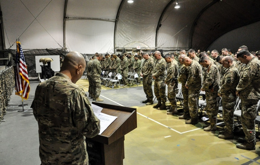 Service members from several units at Bagram Air Field, Afghanistan, pay their respects during a fallen comrade ceremony held in honor of six Airmen Dec. 23, 2015. The six Airmen lost their lives in an improvised explosive attack near Bagram Dec. 21, 2015.