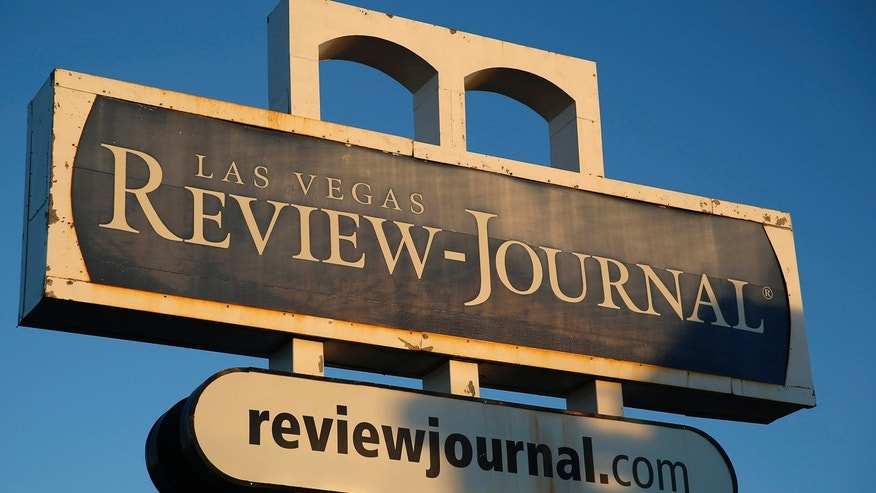 FILE - In this Thursday, Dec. 17, 2015, file photo, an exterior sign for the Las Vegas Review-Journal is seen in Las Vegas. (AP Photo/John Locher, File)