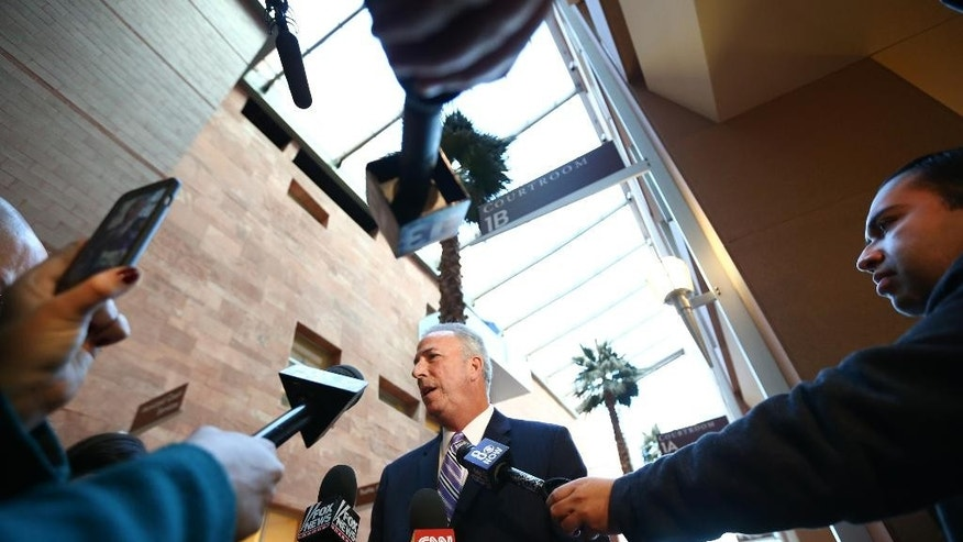Clark County District Attorney Steve Wolfson speaks following the arraignment of Lakeisha Nicole Holloway in district court Wednesday, Dec. 23, 2015, in Las Vegas. Holloway, who crashed her car into pedestrians on the Las Vegas Strip on Sunday, Dec. 20, has been charged with murder, child abuse and hit-and-run. (AP Photo/Chase Stevens)