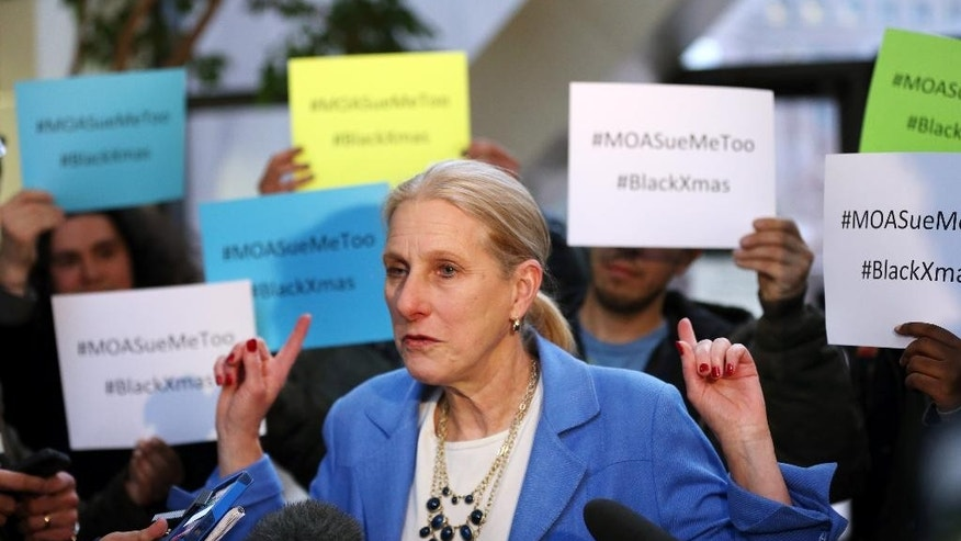 Mall of America attorney Susan Gaertner surrounded by Black Lives Matter protesters.