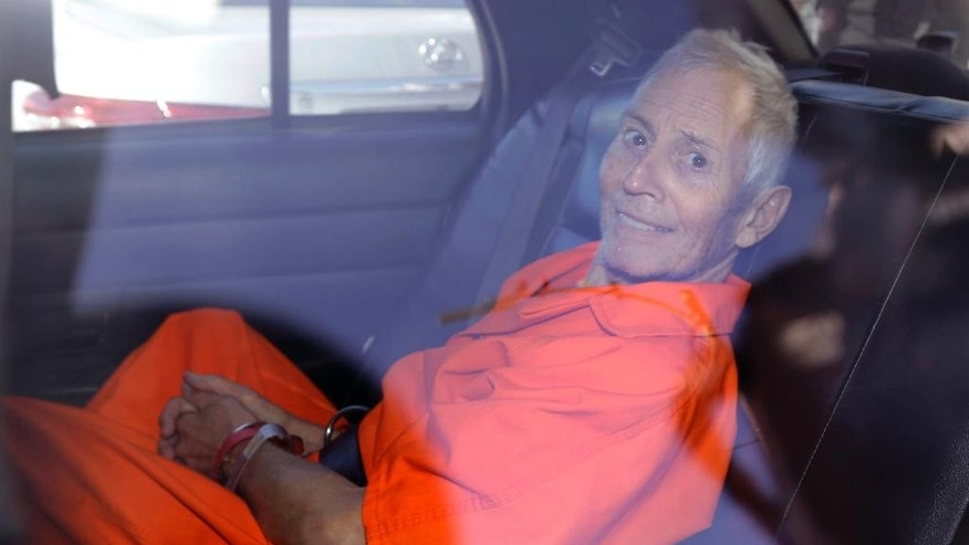 FILE - This Tuesday, March 17, 2015 file photo shows Robert Durst is transported from Orleans Parish Criminal District Court to the Orleans Parish Prison after his arraignment on murder charges in New Orleans. Prosecutors said on Tuesday, Dec. 22, 2015, fugitive real estate heir Durst has agreed to be extradited from Louisiana to Los Angeles by mid-August to face a murder charge. (AP Photo/Gerald Herbert, File)