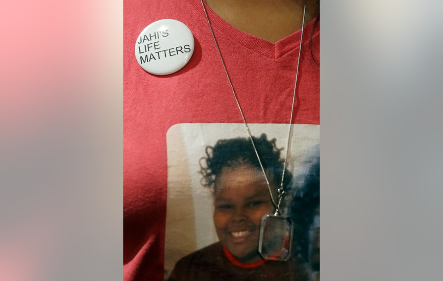 Sandra Chatman, grandmother of Jahi McMath, wears a pin and T-shirt for McMath at a news conference in San Francisco, Wednesday, Dec. 23, 2015. Jahi McMath's mother Nailah Winkfield's two-year quest to have McMath, who was declared brain dead after complications of a tonsillectomy in 2013, declared legally alive is moving to federal court after attempts to secure an order from a state judge ended in failure. (AP Photo/Jeff Chiu)