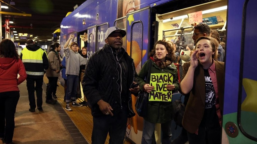 A large protest that started at the Mall of America quickly migrated Wednesday, Dec. 23, 2015, to Minneapolis-St. Paul International Airport, where demonstrators blocked roads and caused significant traffic delays. (Leila Navidi/Star Tribune via AP)