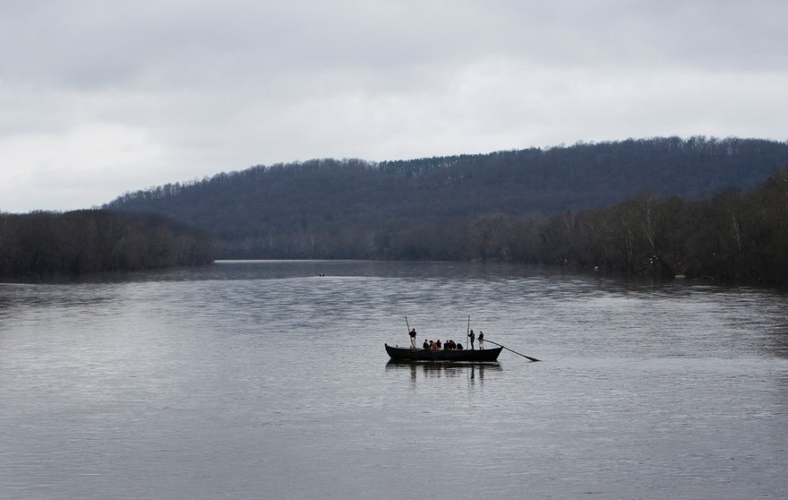 A group of Revolutionary War re-enactors row a Durham boat during the re-enactment of Washington crossing the Delaware River, Friday, Dec. 25, 2015, in Washington Crossing, Pa.  (AP Photo/ Joseph Kaczmarek)