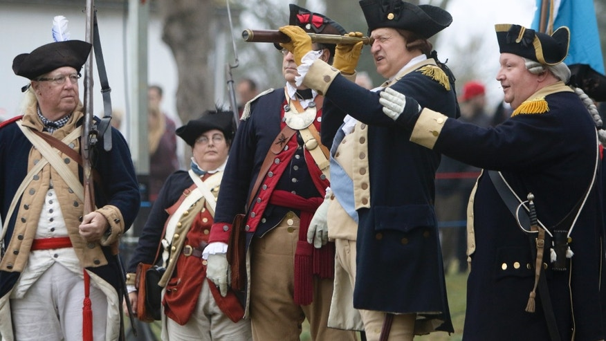 John Godzieba, front left, portraying Gen. George Washington, uses a spy glass to look across the river during a re-enactment of Washington's historic crossing of the Delaware River, Friday, Dec. 25, 2015, in Washington Crossing, Pa. (AP Photo/ Joseph Kaczmarek)