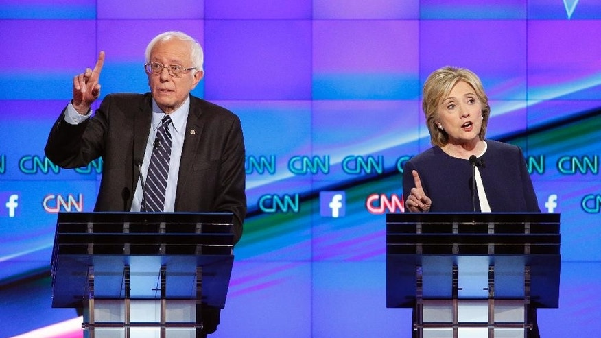 "FILE - In this Oct. 13, 2015, file photo, Democratic presidential candidates Hillary Clinton, right, and Sen. Bernie Sanders, I-Vt., speak during the Democratic presidential debate in Las Vegas. Taunted by Republicans to declare war on ""radical Islamic terrorism,"" Democrats are turning to an unlikely ally: George W. Bush. President Barack Obama, under pressure to be more aggressive on terrorism, regularly cites his predecessor's refusal to demonize Muslims or play into the notion of a clash between Islam and the West. As Clinton put it, ""George W. Bush was right."" And, Sanders visited a mosque this month in a show of solidarity that evoked Bush's visit to a Muslim center just days after 9/11. (AP Photo/John Locher, File)"