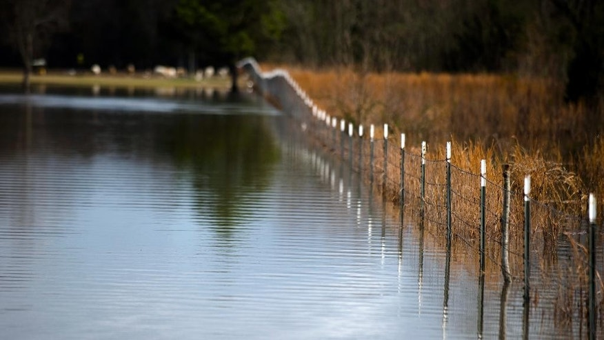 Flood water from the Catoma Creek on Hayneville Road  in Montgomery, Ala., begins to recede on Sat. Dec. 26, 2015. (Albert Cesare/The Montgomery Advertiser via AP)