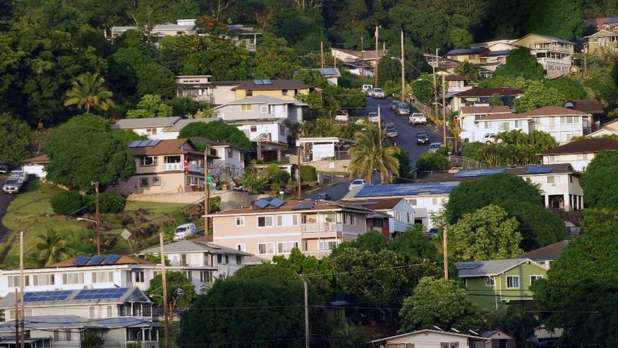 This Thursday, Dec. 24, 2015 photo shows houses in the the Hawaiian homestead community of Papakolea in Honolulu.The state Department of Hawaiian Home Lands has proposed rules that would allow people applying for a homestead lease to use DNA evidence to prove ancestry. (AP Photo/Audrey McAvoy)