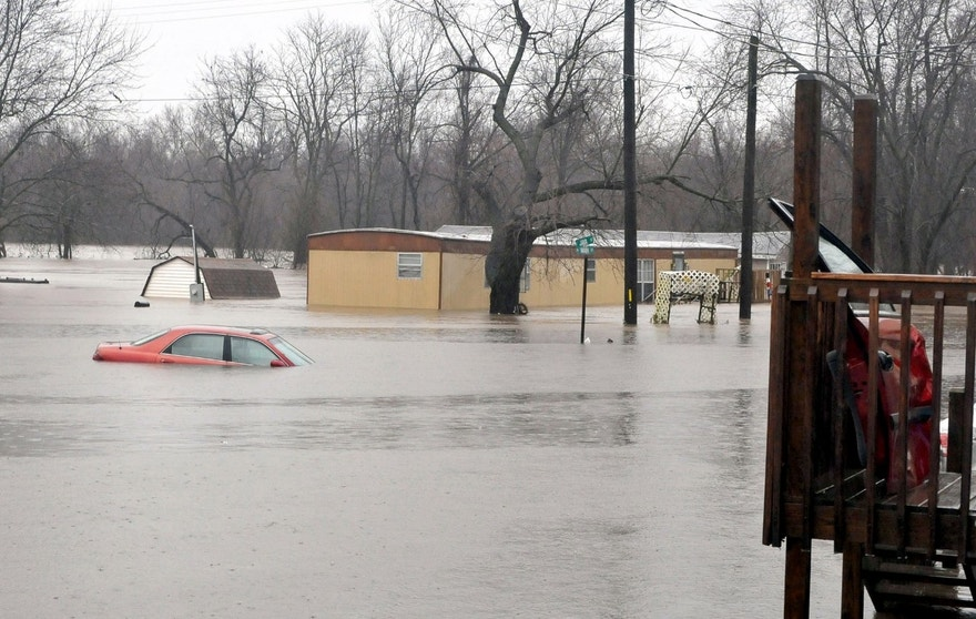 Spring river floods homes in Kendricktown, Mo., Sunday, Dec. 27, 2015. Missouri's governor has declared a state of emergency because of widespread flooding that has led to multiple fatalities. (Willie Brown/The Joplin Globe via AP) MANDATORY CREDIT