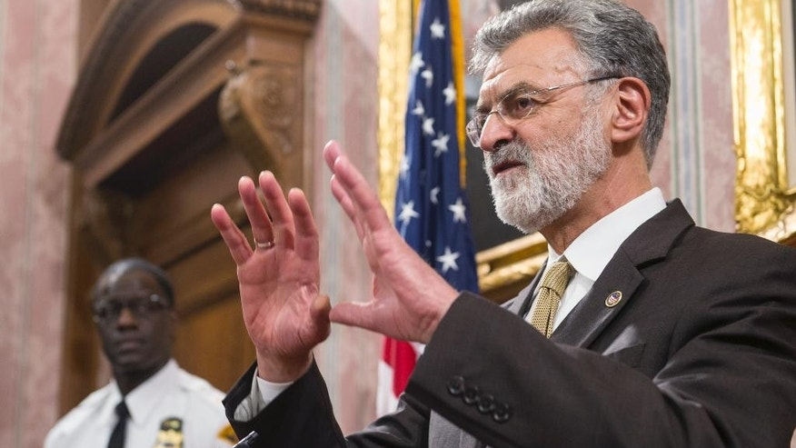 Cleveland mayor Frank Jackson answers questions as police chief Calvin Williams watches during a news conference in Cleveland, Monday, Dec. 28, 2015. Jackson was responding to questions about the Cuyahoga County Grand Jury decision not to indict Cleveland police officer Timothy Loehman for the shooting death of 12-year-old Tamir Rice in Nov. 2014. (AP Photo/Phil Long)