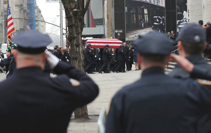 Police officers salute as the casket of Joseph Lemm is carried into St. Patrick's Cathedral in New York for his funeral service, Wednesday, Dec. 30, 2015. Lemm, who was a technical sergeant in the Air Guard's 105th Base Security Squadron and a 15-year veteran of the New York Police Department, was killed when his patrol was attacked by a suicide bomber outside Bagram Air Base in Afghanistan. (AP Photo/Mary Altaffer)