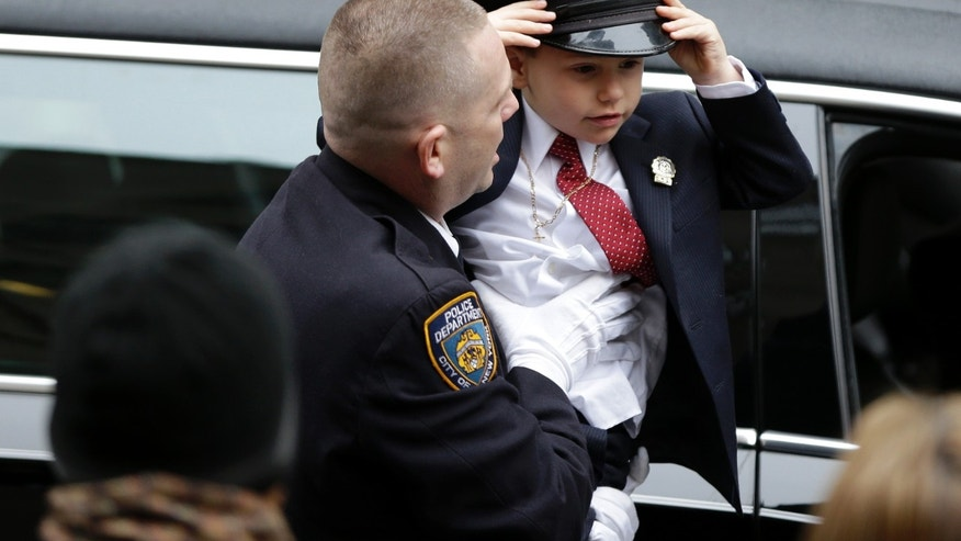Ryan Lemm, 4, son of Joseph Lemm, arrives for his father's funeral.
