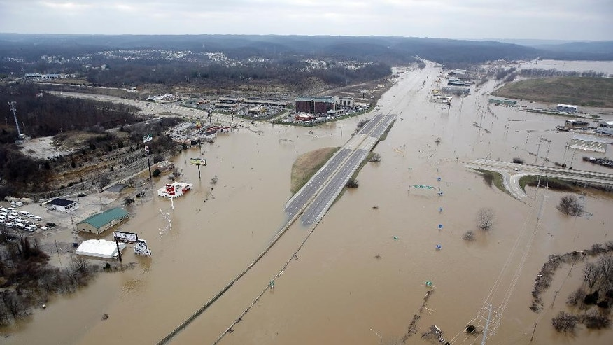 In this aerial photo, flood water covers Interstate 44, Wednesday, Dec 30, 2015, in Valley Park, Mo. A rare winter flood threatened nearly two dozen federal levees in Missouri and Illinois on Wednesday as rivers rose, prompting evacuations in several places. (AP Photo/Jeff Roberson)