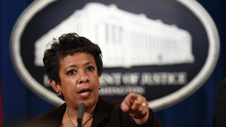 "FILE - In this Dec. 7, 2015 file photo, Attorney General Loretta Lynch speaks during a news conference at the Justice Department in Washington. Incendiary rhetoric has seeped into 2016 presidential politics, surfaced in the public debate over accepting Syrian refugees into the U.S. and popped up repeatedly following terror attacks in Paris and San Bernardino. Lynch expressed concerns this month about an anti-Islam backlash similar to one that followed the Sept. 11 attacks and vowed that the Justice Department would punish ""actions predicated on violent talk."" (AP Photo/Susan Walsh, File)"