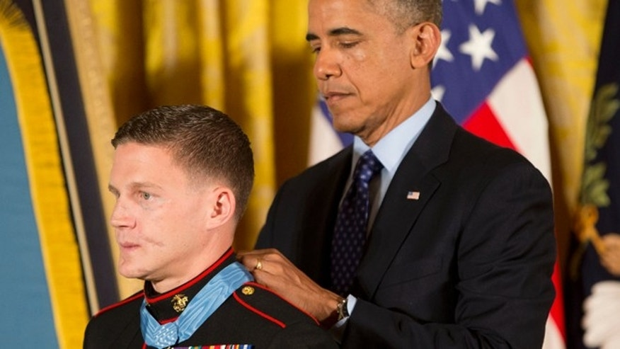 June 19: President Barack Obama awards the Medal of Honor to retired Marine Cpl. William 'Kyle' Carpenter in the East Room of the White House in Washington.