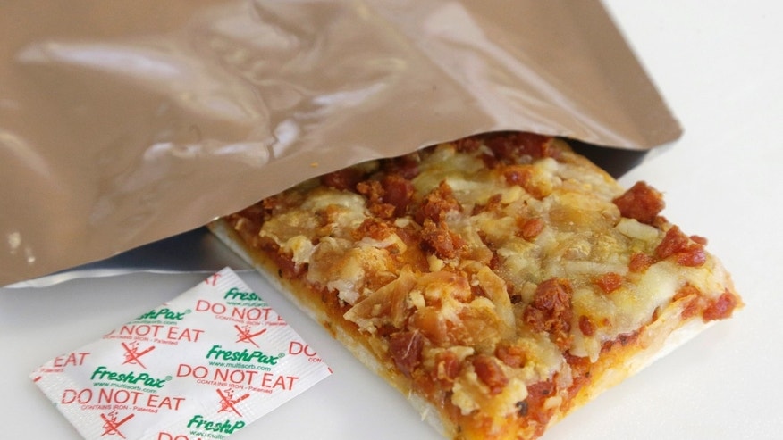 Feb. 6, 2014: A slice of prototype pizza, in development to be used in MRE's -- meals ready to eat -- sits in a packet next to a smaller packet known as an oxygen scavenger, left, at the U.S. Army Natick Soldier Research, Development and Engineering Center in Natick, Mass.