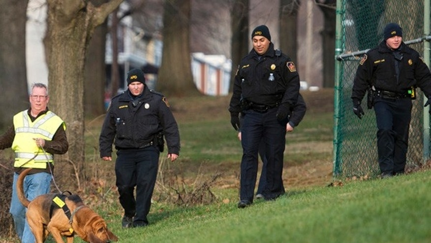 In this Friday, Jan. 1, 2016, photo, Allentown, Pa., police use a search and rescue dog in Keck Park as the search continues for Jayliel Vega Batista, a missing 5-year-old autistic boy who wandered off from a New Year's Eve party on Thursday night. (Chris Shipley/The Morning Call via AP)