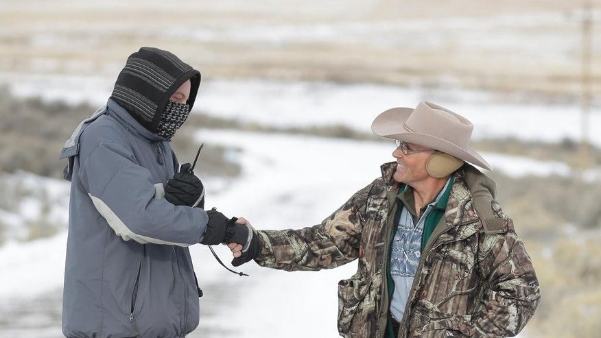 "LaVoy Finicum, right, a rancher from Arizona, shakes hands with a member of the group occupying the Malheur National Wildlife Refuge headquarters on Monday, Jan. 4, 2016, near Burns, Ore. The group calls itself Citizens for Constitutional Freedom and has sent a ""demand for redress"" to local, state and federal officials. (AP Photo/Rick Bowmer)"