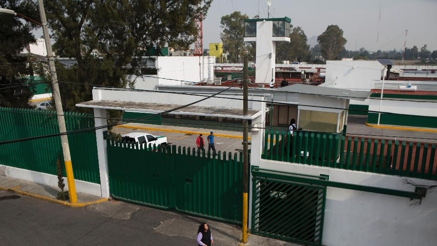 "FILE - In this Dec. 31, 2015 file photo, a woman walks past the Agujas immigration detention center, where U.S. fugitive Ethan Couch is detained in Mexico City. The Mexican lawyer for a Texas teenager known for using an ""affluenza"" defense in a fatal drunken-driving accident said Monday, Jan. 4, 2016 that his appeal against deportation could delay his client's return to the United States for weeks, perhaps months - or just a single day. (AP Photo/Rebecca Blackwell, File)"