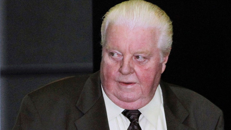 FILE - In this June 8, 2010 file photo, former Chicago Police Lt. Jon Burge arrives at the federal building in Chicago. The city of Chicago has paid $5.5 million in reparations to dozens of people whose claims that they were tortured by a police unit commanded by Burge decades ago were found to be credible. (AP Photo/Charles Rex Arbogast, File)