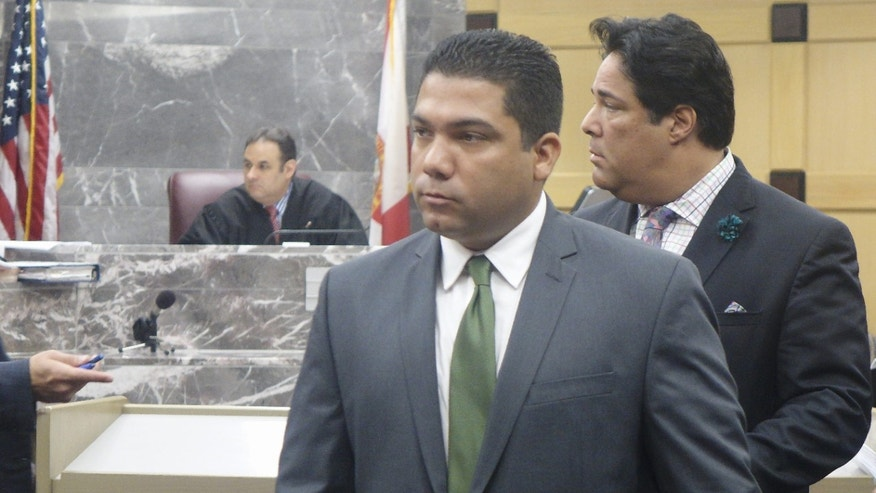 Broward Sheriff's Deputy Peter Peraza, center, in December.
