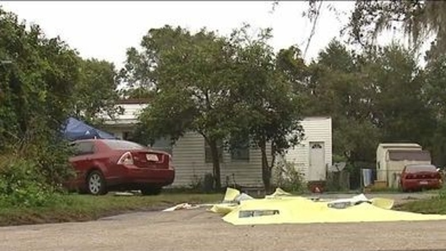 Cops found three people dead and a fourth person wounded at a Lakeland home.