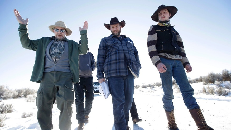 Jan. 8, 2016: Burns resident Steve Atkins, left, talks with Ammon Bundy, center, one of the sons of Nevada rancher Cliven Bundy, following a news conference at Malheur National Wildlife Refuge.