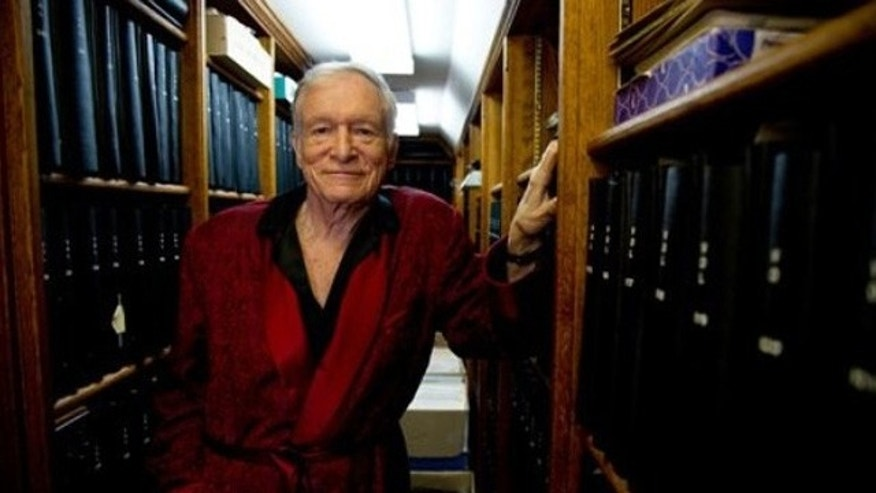 In this Oct. 13, 2011 photo, Playboy Enterprises' Hugh Hefner poses for a photograph at his home at the Playboy Mansion in Beverly Hills, Calif.