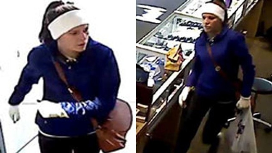 Photo shows surveillance footage allegedly of Abigail Kemp entering a jewelry store.