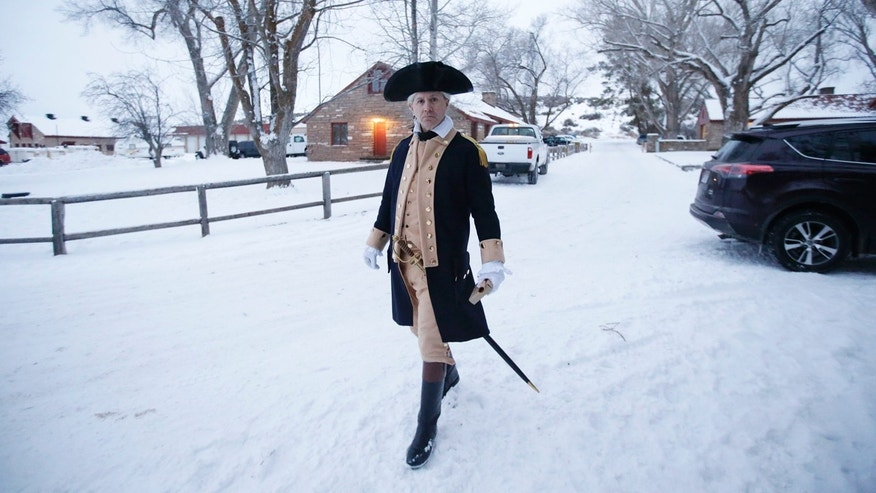 Jan. 10, 2016: A man dressed as continental army officer walks through the Malheur National Wildlife Refuge near Burns, Ore. A small, armed group has been occupying a remote national wildlife refuge in Oregon since a week to protest federal land use policies. (AP Photo/Rick Bowmer)