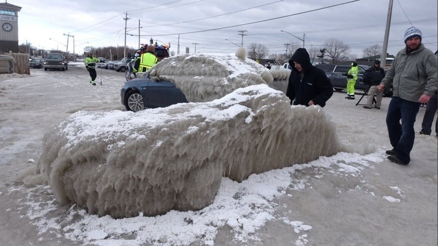 Ice covers cars and signs near Lake Erie in Hamburg, New York.