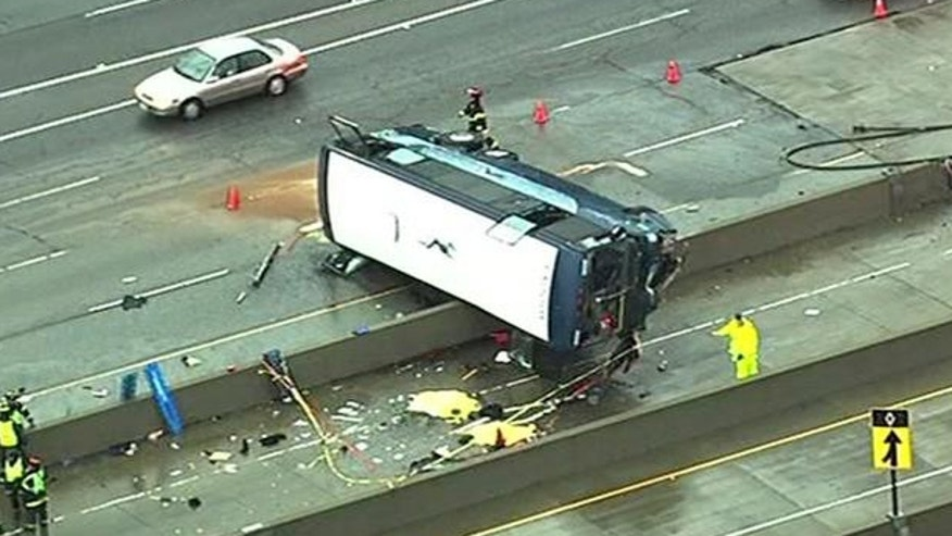 Officials work at the scene of a fatal bus accident in San Jose.