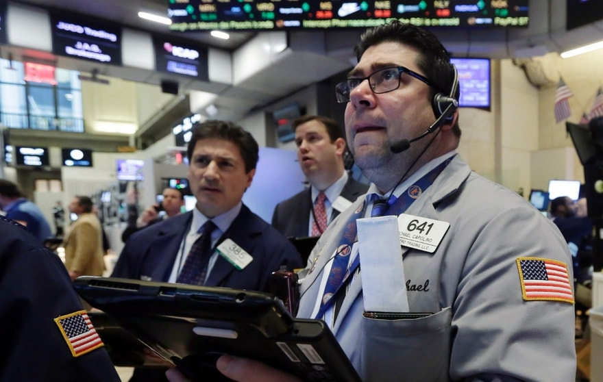 Michael Capolino, right, works with fellow traders on the floor of the New York Stock Exchange, Wednesday, Jan. 20, 2016.  Energy stocks are leading another sell-off on Wall Street as the price of oil continues to plunge. (AP Photo/Richard Drew)