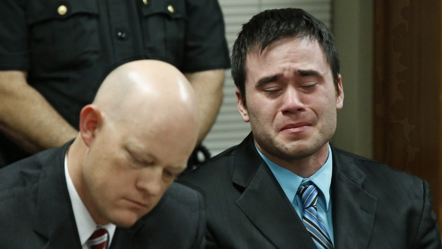 Dec. 10, 2015: Daniel Holtzclaw, right, cries as the verdicts are read in his trial in Oklahoma City.