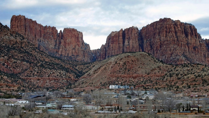 Hildale, Utah sits at the base of Red Rock Cliff mountains with its sister city, Colorado City, Ariz., in the foreground.