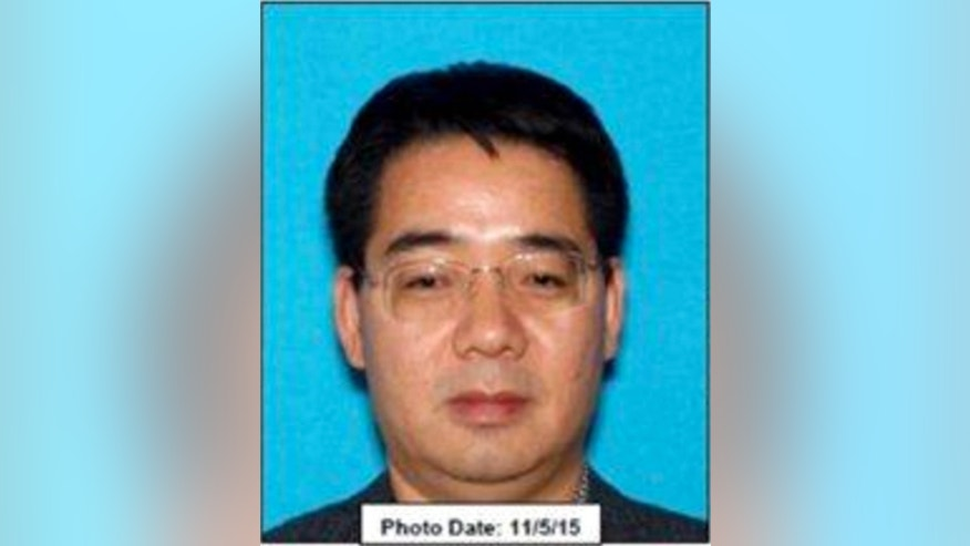 This photo providedby the Los Angeles County Sheriff's Department shows Deyun Shi, 44.
