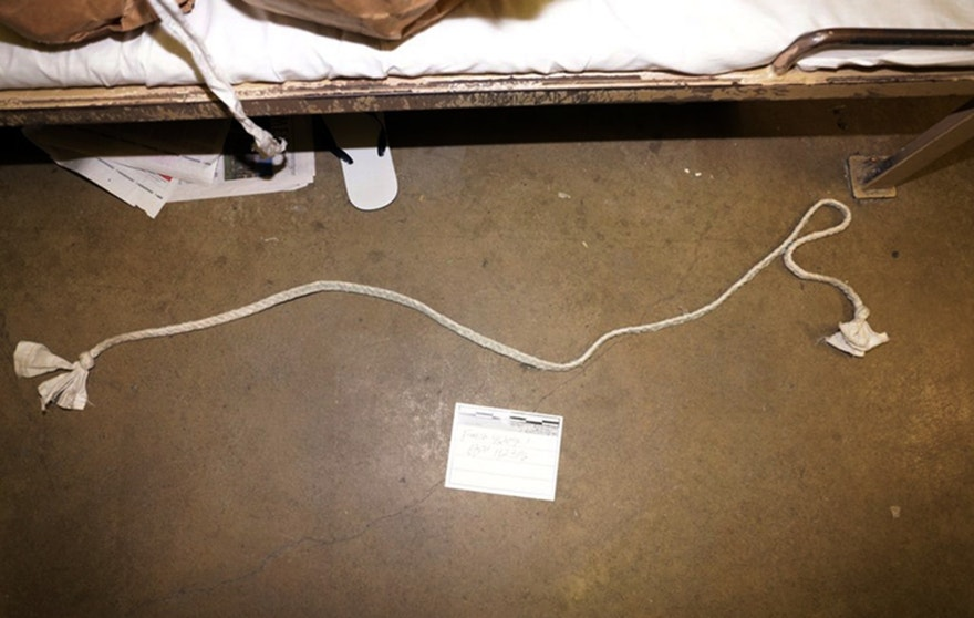 This Saturday, Jan. 23, 2016, photo provided by the Orange County Sheriff's Office shows a cord made of an undetermined fabric that facilitated the escape of three inmates from Central Men's Jail in Santa Ana, Calif., sometime Friday. Investigators are pursuing several leads in their search for the inmates, and in the meantime a separate probe was launched into how the inmates managed to obtain the tools to cut through the steel bars and plumbing tunnels to make it to the roof. (Orange County Sheriff's Office via AP)